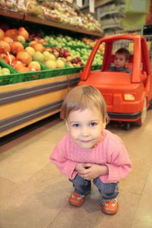 child supermarket photo