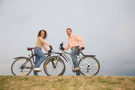 man and woman on the bicycles photo