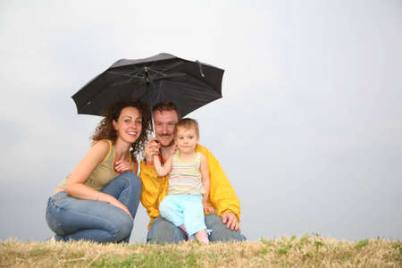 head protection: family with the umbrella
