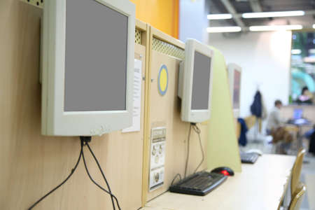 monitors in internet cafe photo