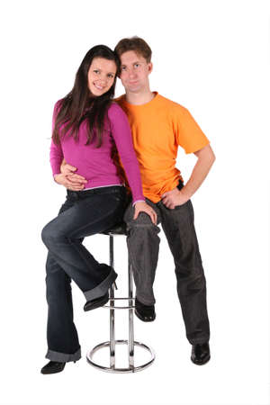 young couple isolated on white sit on bar stool photo