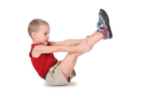 pantalones cortos: yoga muchacho con las piernas arriba  Foto de archivo