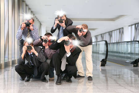 paparazzi with flashes