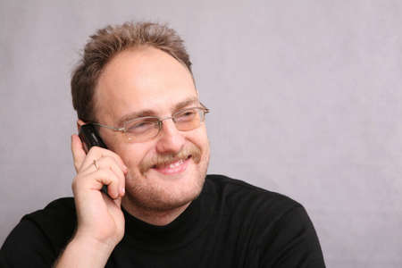 speaks: man with beard speaks on the cell phone