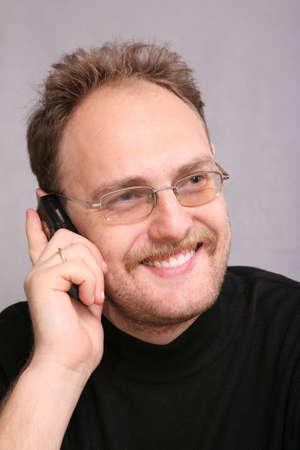 speaks: man with beard speaks on the cell phone 2