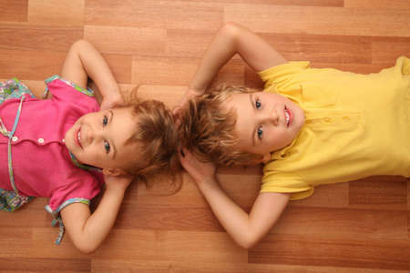 kindred: sister and brother lie on floor Stock Photo