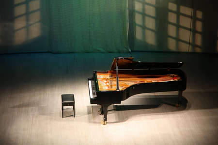 acoustics: piano on  scene in  concert hall Stock Photo