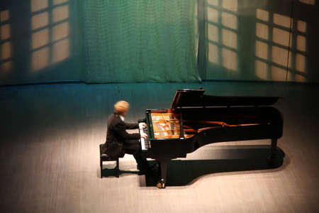 music hall: pianist after the piano on the scene Stock Photo