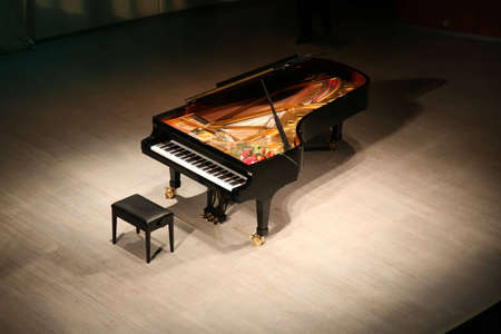 music hall: piano with  bouquet of flowers on scene in  concert hall