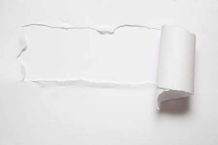 paper hole: the sheet of torn paper against the white background Stock Photo