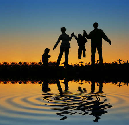 family on sunset pond Stock Photo - 3010018