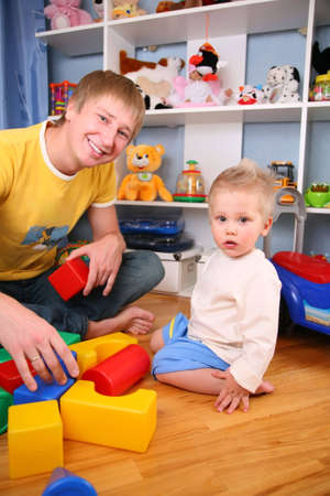 father and child in playroom 2 photo