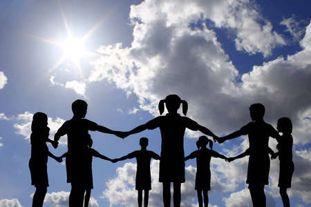 community support: children circle on real sunny sky