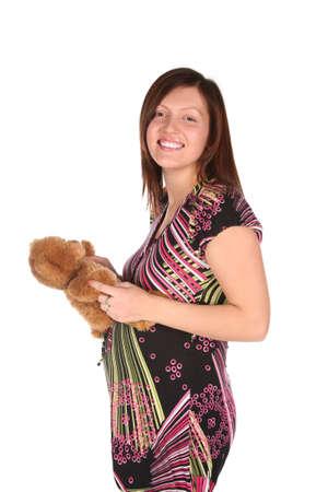 pregnant woman with teddy bear photo