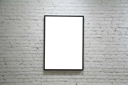 painted wall: one black frame on white brick wall Stock Photo
