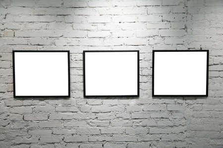 black frames on white brick wall 2 photo
