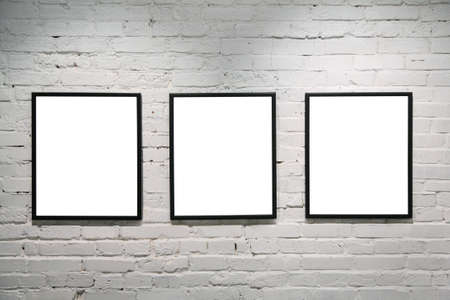 canvas on wall: black frames on white brick wall 3 Stock Photo