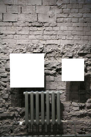 gallerie: two blank frames on grey brick wall Stock Photo