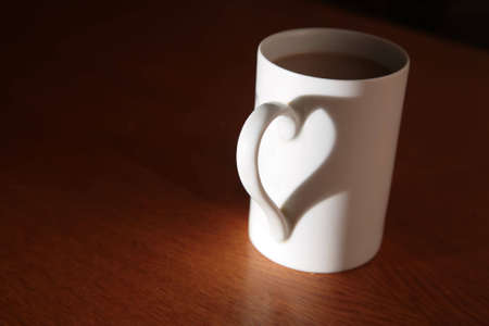 morning: white cup full of drink Stock Photo