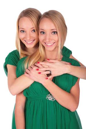 bambine gemelle: Twin ragazze una dietro  Archivio Fotografico
