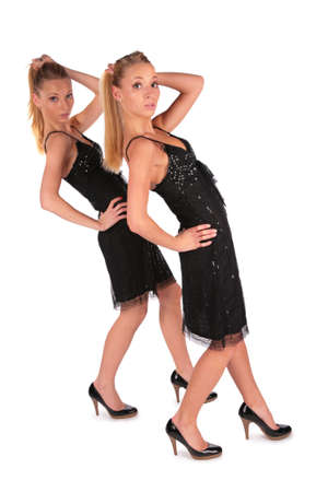 Twin girls. Incline behind hand up. Stock Photo - 3012598