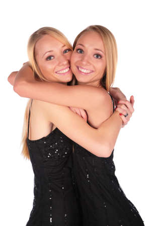 bambine gemelle: Twin ragazze abbracciando
