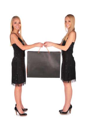 bambine gemelle: Twin ragazze azienda sacchetto  Archivio Fotografico