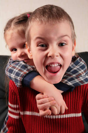 girl embraces boy for the neck, aggressive defence boy photo