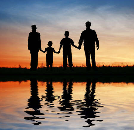 family of four on sunset sky, water Stock Photo - 3019479