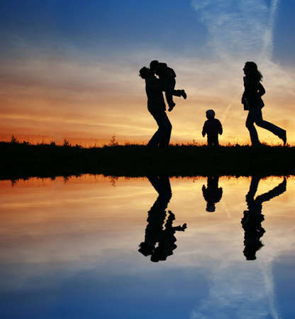 silhouette family of four and water Stock Photo - 3019476