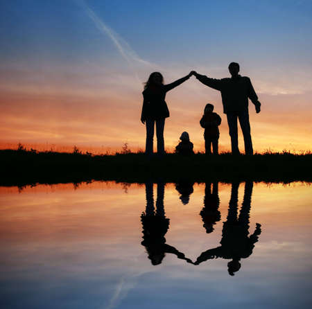 silhouette family house on sunset water Stock Photo - 3019427