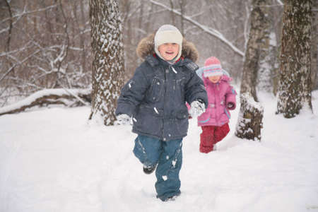 two children in forest in winter photo