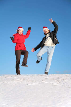 couple dance on  snow hill in santa claus hats Stock Photo - 3023332