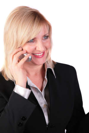 Middleaged businesswoman with cellphone 2 photo