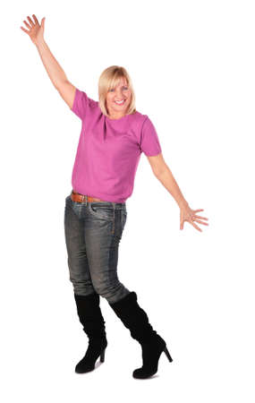 middleaged woman in pink shirt stands dancing 3 photo