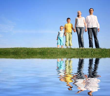 family grass sky water photo