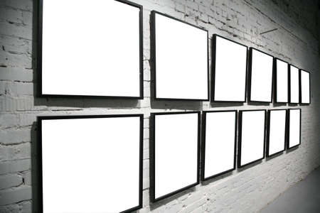two rows frames on brick white wall photo