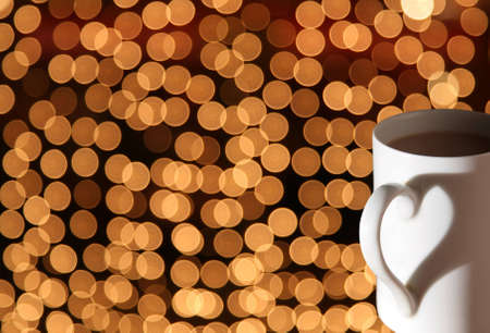 cup with shadow heart on bokeh lights Stock Photo - 3030675