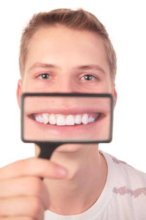 man shows  smile through  magnifier photo