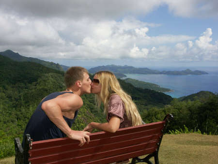 kissing couple on bench photo