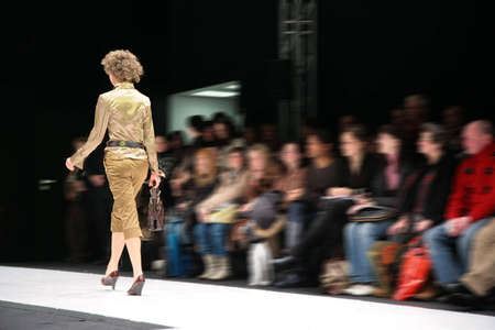 fashion catwalk: fashion model on podium from back