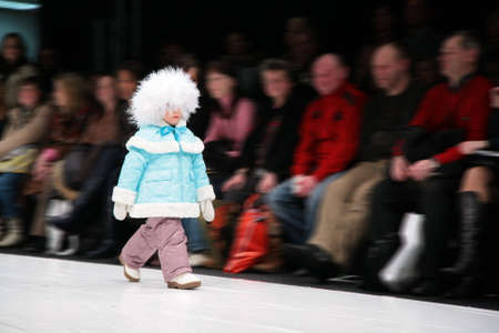 little girl in winter clothes on catwalk photo
