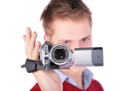 Boy in red jacket with HDV camera photo