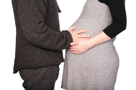 Pregnant couple in woolen dresses photo