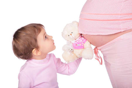 Little girl with toy and pregnant photo