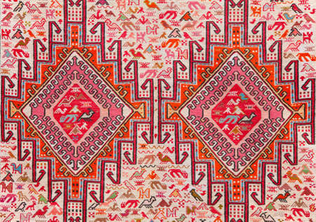 carpet with animalistic ornament photo