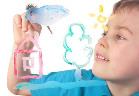 boy paints on glass cloud and house photo