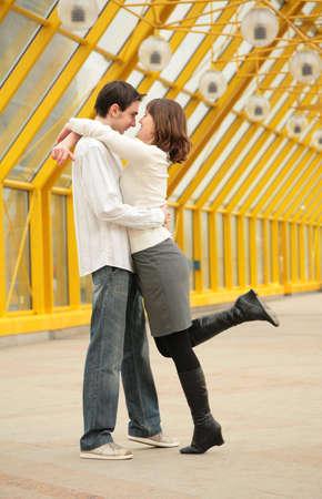 Young couple on footbridge photo