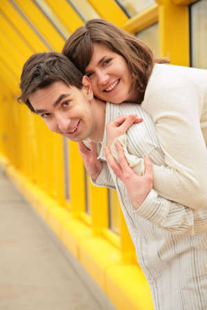 girl embraces boy on  footbridge Stock Photo - 5155498
