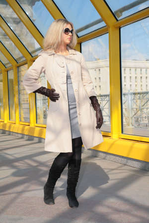 diagonals: young blonde in sunglasses and black gloves Stock Photo